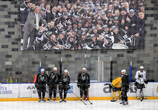 Los Angeles Kings players stand under a banner from their 2012 championship season during practice on Friday. (USA TODAY SPORTS)