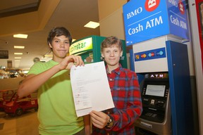 Caleb Turon (left) and Matthew Hewlett hacked a Bank of Montreal ATM and then alerted bank staff to the vulnerability of the ATM.  The 14 year olds were late returning to school from lunch, but had a note from the bank indicating they were helping with security. (Chris Procaylo/Winnipeg Sun/QMI Agency)