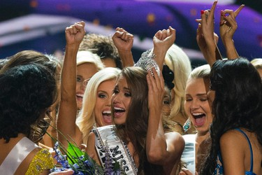 Fellow contestants celebrate with Miss Nevada Nia Sanchez after she won the 2014 Miss USA beauty pageant in Baton Rouge, La., on June 8, 2014. (REUTERS/Adrees Latif)