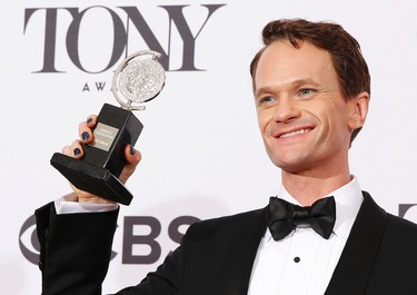 """Neil Patrick Harris poses backstage with his Tony Award for Best Performance by an Actor in a Leading Role in a Musical for """"Hedwig and the Angry Inch"""" during the American Theatre Wing's 68th annual Tony Awards at Radio City Music Hall in New York, June 8, 2014.REUTERS/Andrew Kelly"""