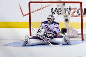 Goaltender Henrik Lundqvist #30 of the New York Rangers sits on the ice after allowing the game winning goal in double overtimeduring Game 2 of the Stanley Cup final at the Staples Center on June 7, 2014. (Victor Decolongon/Getty Images/AFP)