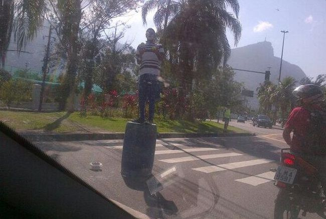 """As you inch by Ipanema Beach waiting for yet another red light, a young man with white face on, rolls out a plastic barrel in the intersection stands on it and proceeds to juggle. He jumps down after his performance and with cap in hand goes looking for contributions. He doesn't realize how much of a rich man he already is having escaped injury."" (Twitter.com/MoDaCoatLFPress)"
