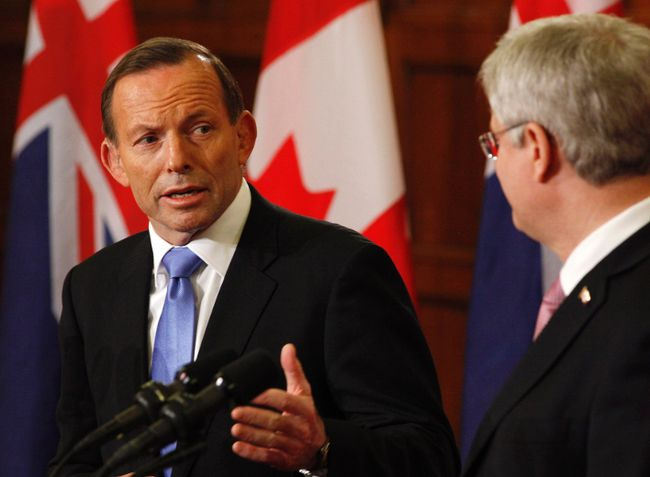 Prime Minister Stephen Harper (R) and his Australian counterpart Tony Abbott hold a joint news conference after a meeting on Parliament Hill in Ottawa June 9, 2014. REUTERS/Patrick Doyle