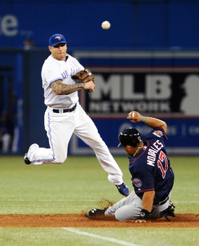 Toronto Blue Jays second baseman Brett Lawrie throws to first base for a double play against the Minnesota Twins at the Rogers Centre in Toronto, June 9, 2014. (DAN HAMILTON/USA Today)