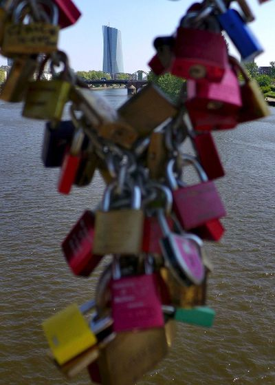 <b>Frankfurt:</b> Love locks are pictured at the famous iron bridge (Eiserner Steg) with the new headquarters of the European Central Bank (ECB) in the background at the river Main in Frankfurt, Germany. REUTERS/Kai Pfaffenbach