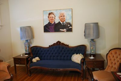 A settee that once belonged to Canada's first prime minister John A. Macdonald is on display at the former home of the country's 13th prime minister John Diefenbaker in Prince Albert. A portrait of Diefenbaker and wife Olive hangs above it. BARBARA TAYLOR/QMI AGENCY