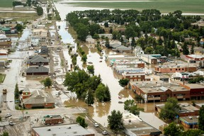 Water takes over downtown High River at the height of the June 2013 flood. (Lyle Aspinall/Calgary Sun)
