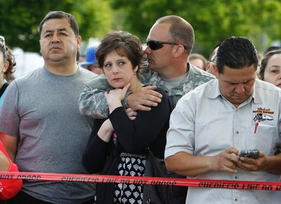 Parents wait to be reunited with students after a shooting at Reynolds High School in Troutdale, Oregon June 10,  2014.  REUTERS/Steve Dipaola