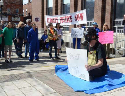 Kim Allerton speaks at a rally held on the steps of Owen Sound city hall to bring awareness about climate change in May 2014.