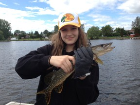 Camryn Heidman shows a typical northern pike from Whitewater Lake.