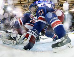 New York Rangers centre Derek Stepan pushes the puck underneath goalie Henrik Lundqvist during Game 4 of the Stanley Cup final against the Los Angeles Kings at Madison Square Garden in New York, June 11, 2014. (BRUCE BENNETT/Pool/USA Today)
