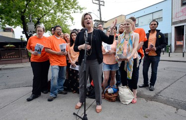 Ontario NDP leader Andrea Horwath speaks during a photo opportunity as she campaigns on the final day of the election in Toronto, Ontario, June 12, 2014. Two days before Thursday's election day in Ontario and polls show a dead heat between a left-leaning Liberal government that many feel has overstayed its welcome and an austerity-minded Conservative opposition that has failed to capture the imagination of voters. According to an Ekos poll, the Liberals lead with 34.7 percent, just ahead of the Conservatives at 34.5 percent. The New Democratic Party, led by Horwath, has 19.8 percent. REUTERS/Aaron Harris