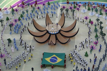 Singers Pitbull, Jennifer Lopez and Brazil's Claudia Leitte perform during the 2014 World Cup opening ceremony at the Corinthians arena in Sao Paulo June 12, 2014.