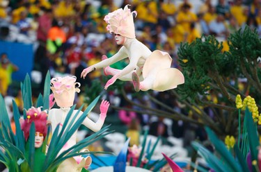 Performers participate in the opening ceremony of the 2014 World Cup at the Corinthians arena in Sao Paulo June 12, 2014.