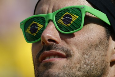 A fan poses before the opening ceremony of the 2014 World Cup at the Corinthians arena in Sao Paulo June 12,2014.
