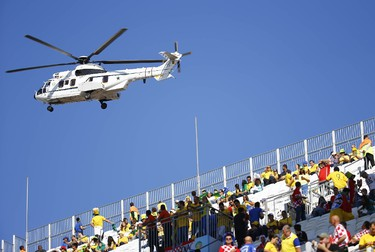 A security helicopter flies over the Corinthians arena before the opening ceremony in Sao Paulo June 12,2014.