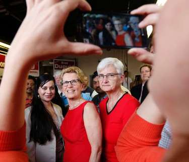 Premier Kathleen Wynne attends a rally at Tracy MacCharles' Pickering-Scarborough East campaign office on Tuesday, June 10, 2014. (MICHAEL PEAKE/Toronto Sun)