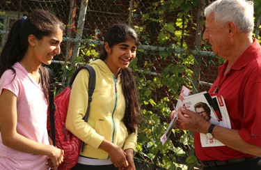 York West Liberal incumbent Mario Sergio speaks with future voters in his riding on Wednesday, June 11, 2014. (DAVE THOMAS/Toronto Sun)