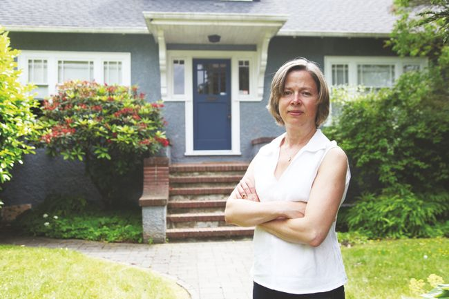 "Caroline Adderson, a member of the Vancouver Character House Network, stands in front of a 1928 house slated for demolition in her Dunbar neighbourhood — what she calls ""bulldozer bait."" 