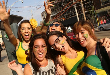 Soccer fans celebrate outside BrazilianStar Cafe on Dundas St. in Torontoafter Brazil won the World Cup opener against Croatia on June 12.
