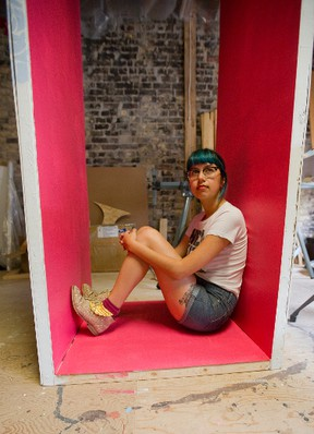 Megan Arnold sits inside her Nuit Blanche exhibit entitled Cheap Romance. (MIKE HENSEN, The London Free Press)