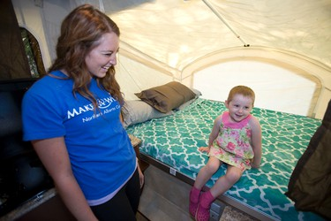 Aiva, 3, plays with wish granter Natasha Gacek in her new trailer at Rainbow Valley Campground in Edmonton, Alta., Thursday, June 12, 2014 during a Make-A-Wish Northern Alberta event. The three-year-old, who has leukemia, wished for a camping trailer, which was granted by ArrKann Trailer & RV Centre, to go camping with her family. Ian Kucerak/Edmonton Sun/QMI Agency