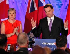 Ontario Progressive Conservative leader Tim Hudak concedes defeat in Ontario's election as his wife Debbie Hutton stands by his side in Grimsby, Ontario June 12, 2014. (REUTERS/Fred Thornhill)