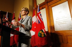Ontario Premier Kathleen Wynne speaks to media in front of her office at Queen's Park in Toronto the morning after her government was re-elected with a majority on Friday, June 13, 2014. (MICHAEL PEAKE/Toronto Sun)