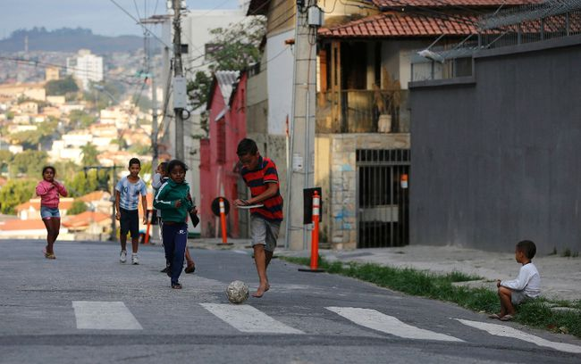 Kids play soccer on a street outside Independencia stadium before the start of the Argentine national team training session in preparation for 2014 World Cup in Belo Horizonte, June 11, 2014. (REUTERS/Leonhard Foeger)