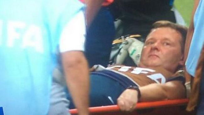 Gary Lewin, England's physio trainer, had to be stretchered off the sidelines after dislocating his ankle while celebrating a goal. (BBC)