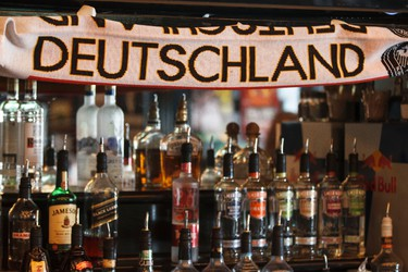 A Deutschland flag hangs over the bar as Germany and Portugal fans cheer during the World Cup game between the two nations at the Pint Public House at 10125 109 Street in Edmonton, Alta., Monday, June 16, 2014. Germany won 4-0. Ian Kucerak/Edmonton Sun/QMI Agency