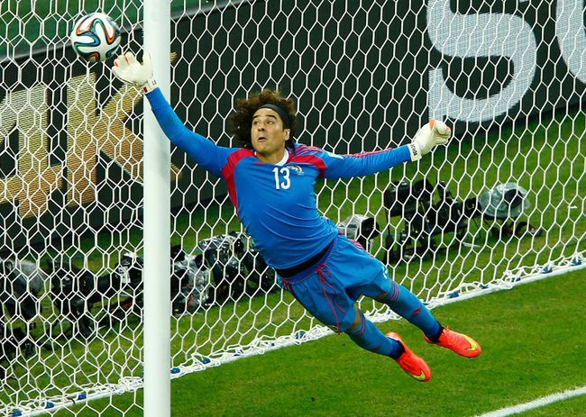 Mexico's Guillermo Ochoa jumps to save the ball during their World Cup match against Brazil at the Castelao arena in Fortaleza, Brazil on Tuesday, June 17, 2014. (Mike Blake/Reuters)