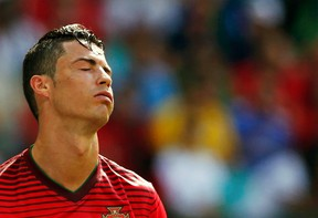 According to reports, Portugal star Cristiano Ronaldo should rest his knee or risk ending his career. (Reuters)