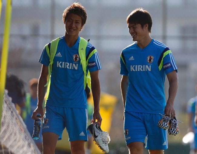 Japan's national soccer team players Hiroki Sakai (L) and Gotoku Sakai walk towards the pitch before the training session at Japan's team base camp in the town of Itu north-west of Sao Paulo June 17, 2014.  (REUTERS/Maxim Shemetov)