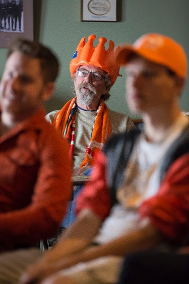 Ross Campbell (centre) watches the Netherlands-Australia World Cup soccer game at the Dutch Canadian Club in Edmonton, Alta., on Wednesday, June 18, 2014. The Dutch won 3-2. Ian Kucerak/Edmonton Sun/QMI Agency