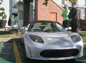 This Tesla Roadster, getting a charge at the new EV station at the Downtown Chatham Centre, is an all-electric vehicle known for its high performance.