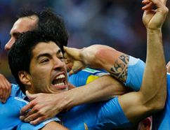 """England manager Roy Hodgson doesn't think Uruguay's Luis Suarez isn't """"world class"""" despite scoring two goals against his team. (REUTERS)"""