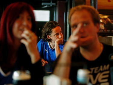 Team Italy die-hard fan Steve Travanut can hardly bare to watch his team go down to defeat 1-0 to Costa Rica at The Pint Public House at 10125-109 St., in Edmonton, Alta., on Friday June 20, 2014. Tom Braid/Edmonton Sun/QMI Agency