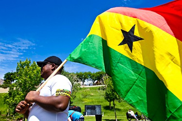 Ghana fan Max Adu-Safo holds his country's flag during a viewing party at Louise McKinney Park as Germany takes on Ghana in FIFA World Cup action in Edmonton, Alta., on Saturday, June 21, 2014. The match ended in a 2-2 draw. Codie McLachlan/Edmonton Sun/QMI Agency