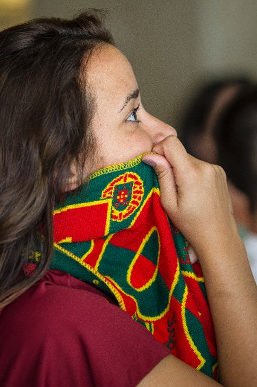 Portugal fan Vanessa Pinto watches the World Cup game between Portugal and the USA at Cafe De Gama in Edmonton, Alta., on Sunday, June 22, 2014. Ian Kucerak/Edmonton Sun/QMI Agency