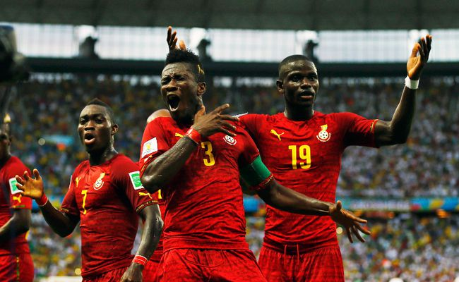 Ghana's Asamoah Gyan (centre) dances with teammates Christian Atsu (left) and Jonathan Mensah after scoring against Germany during their World Cup Group G match at Castelao Arena in Fortaleza, Brazil, June 21, 2014. (MARCELO DEL POZO/Reuters)