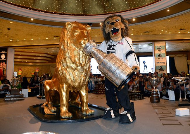 Kings mascot Bailey has a little fun with the Stanley Cup at a display of NHL trophies at the MGM Grand Hotel/Casino yesterday in Las Vegas. The awards will be handed out tonight.