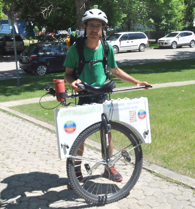 Joseph Boutilier stops in Portage la Prairie during his Unity for Climate Change journey from Victoria, B.C., to Ottawa, Ont. Boutilier is unicycling across the country to raise awareness of climate change. (Johnna Ruocco/THE GRAPHIC/QMI AGENCY)