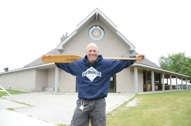 Presqu'ile Rotary Youth Camp director Andy Barnard stands outside the main hall at the camp earler this week. This summer the camp is marking 85 years under ownership of the Owen Sound Rotary Club. (Rob Gowan The Sun Times)