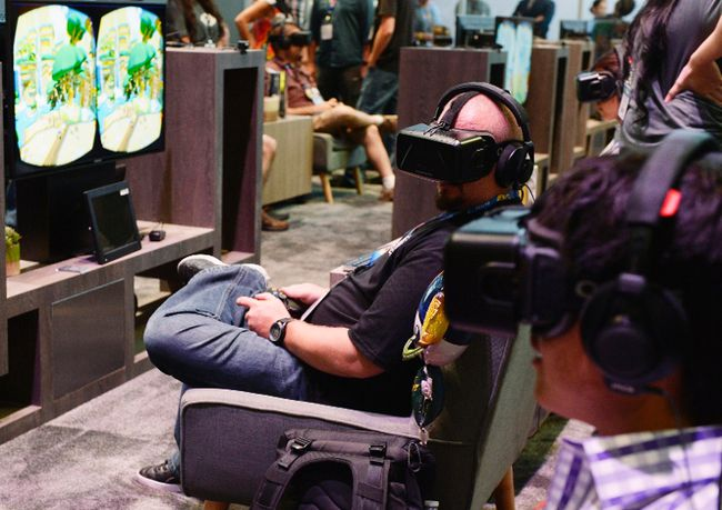 An attendee tries on the Oculus VR Inc. Rift Development Kit 2 headset at the 2014 Electronic Entertainment Expo (E3) in Los Angeles,  June 11, 2014.  REUTERS/Kevork Djansezian