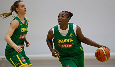 Brazil's Leila Zabani, left, and Clarissa Santos, right, take part in a basketball practice at the Saville Community Sports Centre in Edmonton, Alta., on Wednesday, June 25, 2014. Team Canada will take on Team Brazil on June 26, 27 and 28 in a three game series during the Edmonton Grads International Classic. Codie McLachlan/Edmonton Sun/QMI Agency