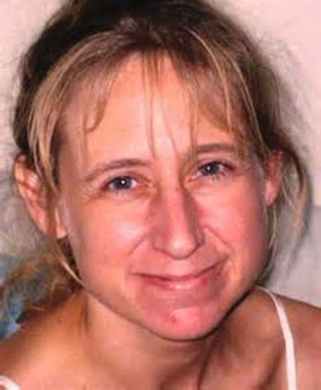 Laura Simonson, 37, is pictured in this handout photo provided by the Farmington Police Department, June 25, 2014. Steven Zelich, 52, was taken into custody on Wednesday in connection with the deaths of two women whose bodies were found in separate suitcases along a rural road earlier this month, authorities said. One of the victims was identified as Laura Simonson, 37, of Farmington, Minnesota, who was reported missing in November. REUTERS/Farmington Police Department/Handout via Reuters
