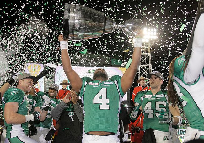 Roughriders quarterback Darian Durant hoists the Grey Cup after beating the Tiger-Cats 45-23 in Regina on Nov. 24, 2013. (Lyle Aspinall/QMI Agency/Files)
