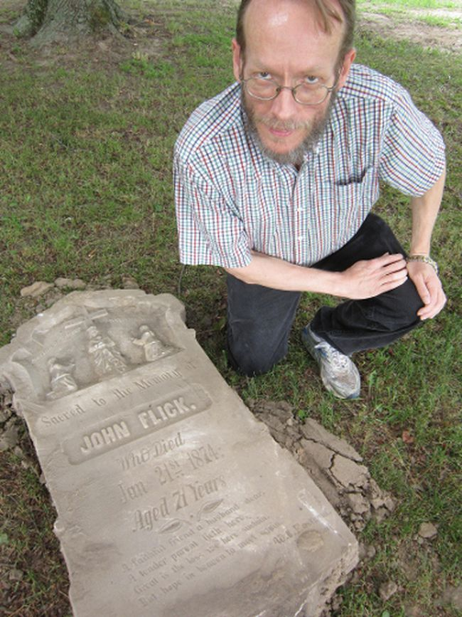 Delhi historian Dan Walker with one of about 25 headstones recovered last week during an excavation at the old Catholic cemetery south of LaSalette. (MONTE SONNENBERG / SIMCOE REFORMER)