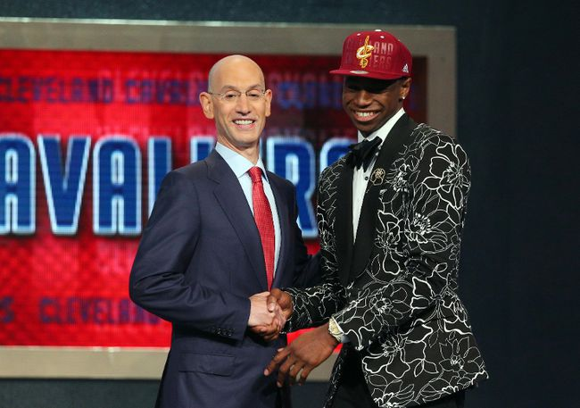Andrew Wiggins shakes hands with NBA commissioner Adam Silver after being selected first overall by Cleveland Cavaliers in the NBA Draft at the Barclays Center in New York, June 26, 2014. (BRAD PENNER/USA Today)
